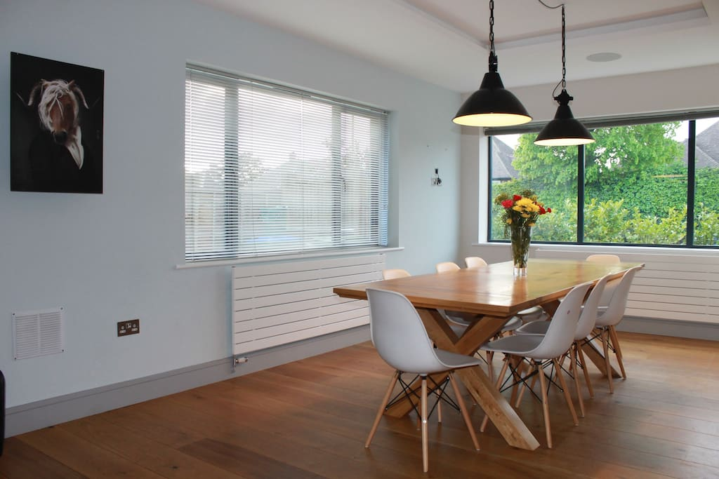 Open plan dining area with wood fire