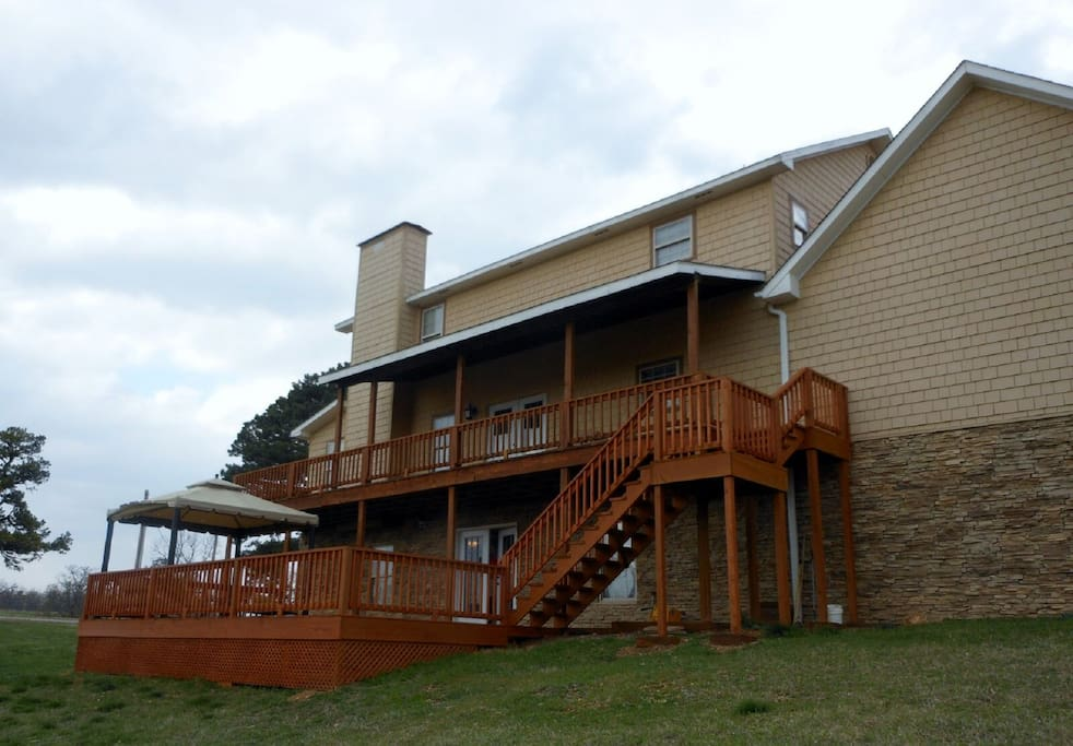 2 level large back deck, includes, lighted gazebo, fire pit, seating, BBQ  grill