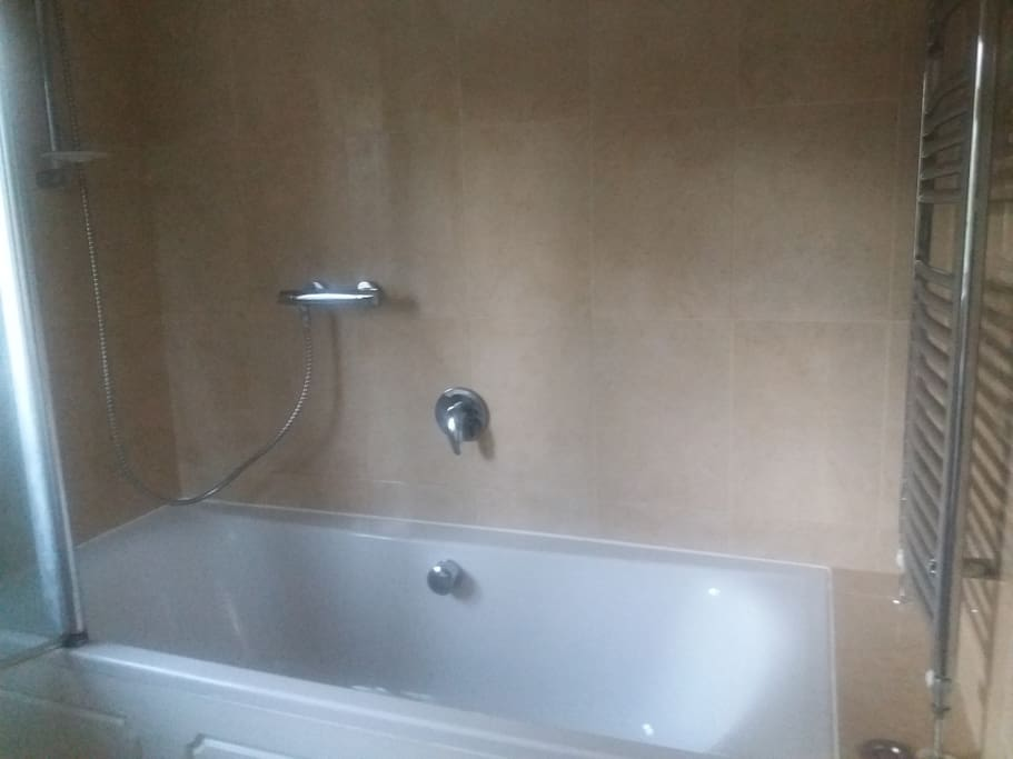 Shared bathroom with oversized bath.