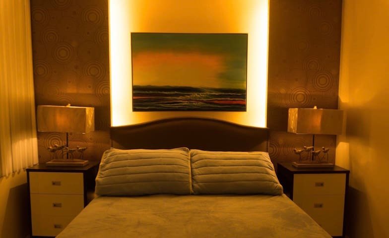 Masters Bedroom located at the lower floor with 1 queen size bed / 1 extra mattress