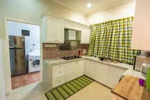 Kitchen: Hood & hob, microwave, fridge and washing machine