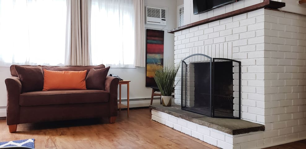 Wood burning fireplace and sitting area, love seat turns into a twin sleeper.
