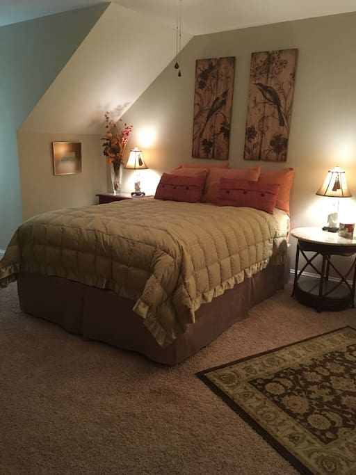 Queen bed with feather topper