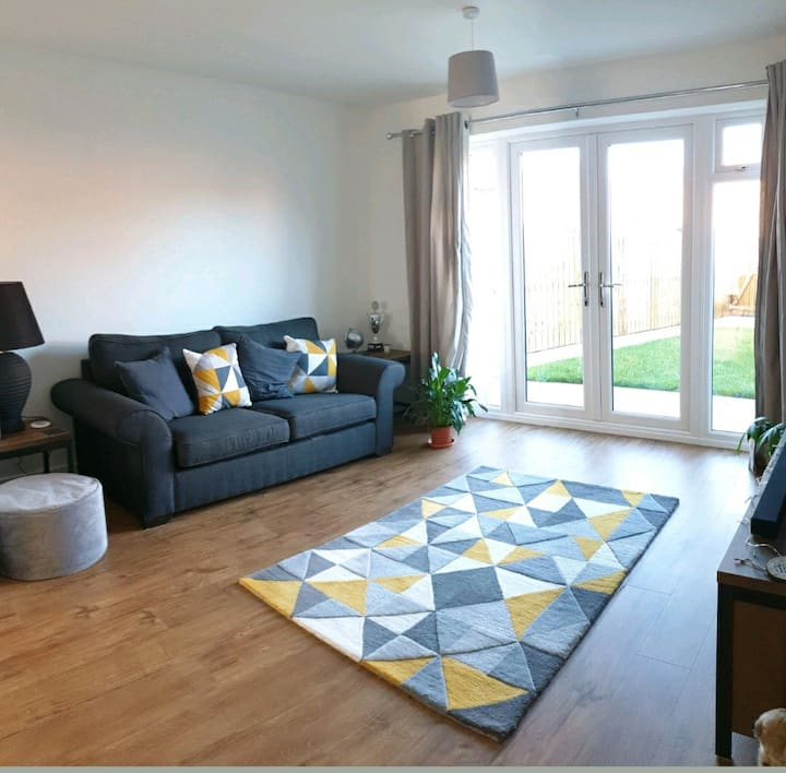 Cosy room in a modern, spacious 2 bedroom house.