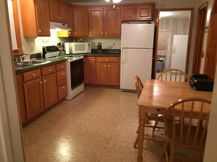 Spacious fully stocked kitchen with comfortable seating for six.