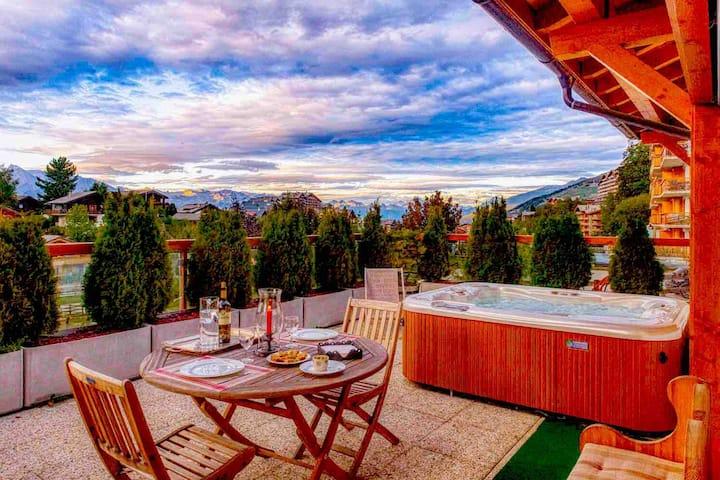 Appartement de luxe avec Jacuzzi sur la terrasse.