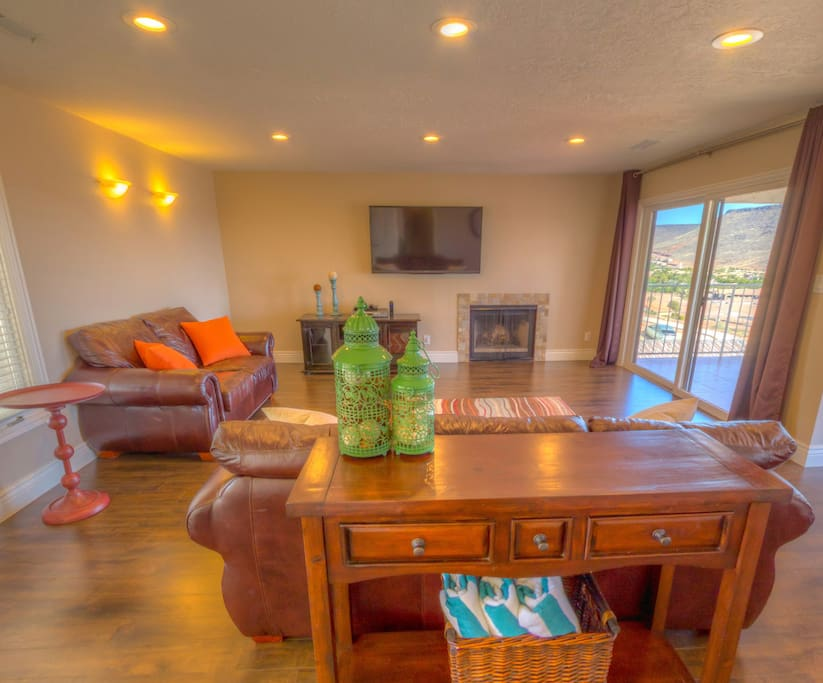 Spacious living area with smart tv, comfortable couches, and views!
