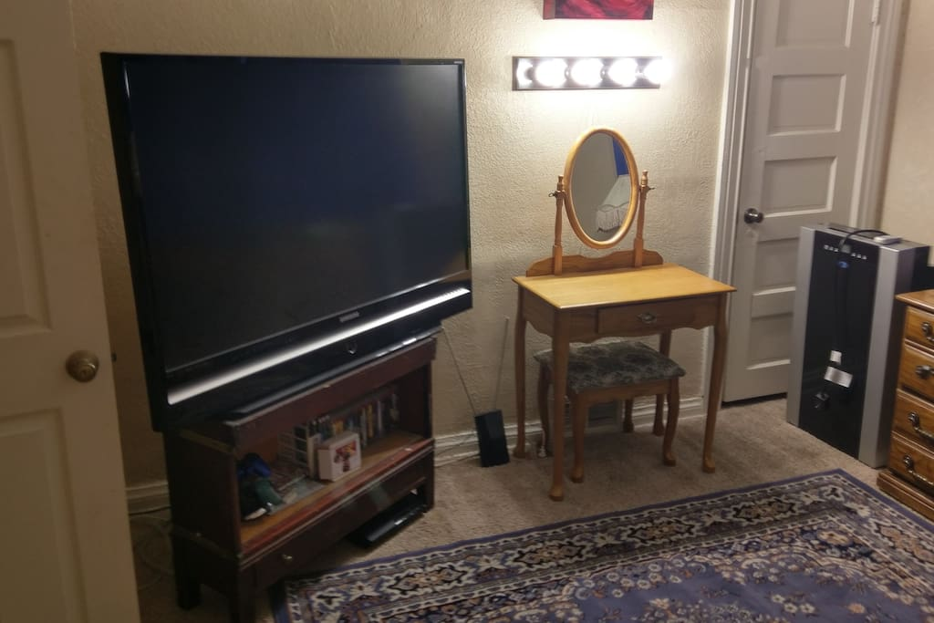 """56"""" HDTV with Playstation 3 (and many games), OTA antenna and Chromecast (broadcasts content and streaming from your phone).  Also vanity with strong lighting, and 14,000BTU air conditioner for hot Denver summers."""