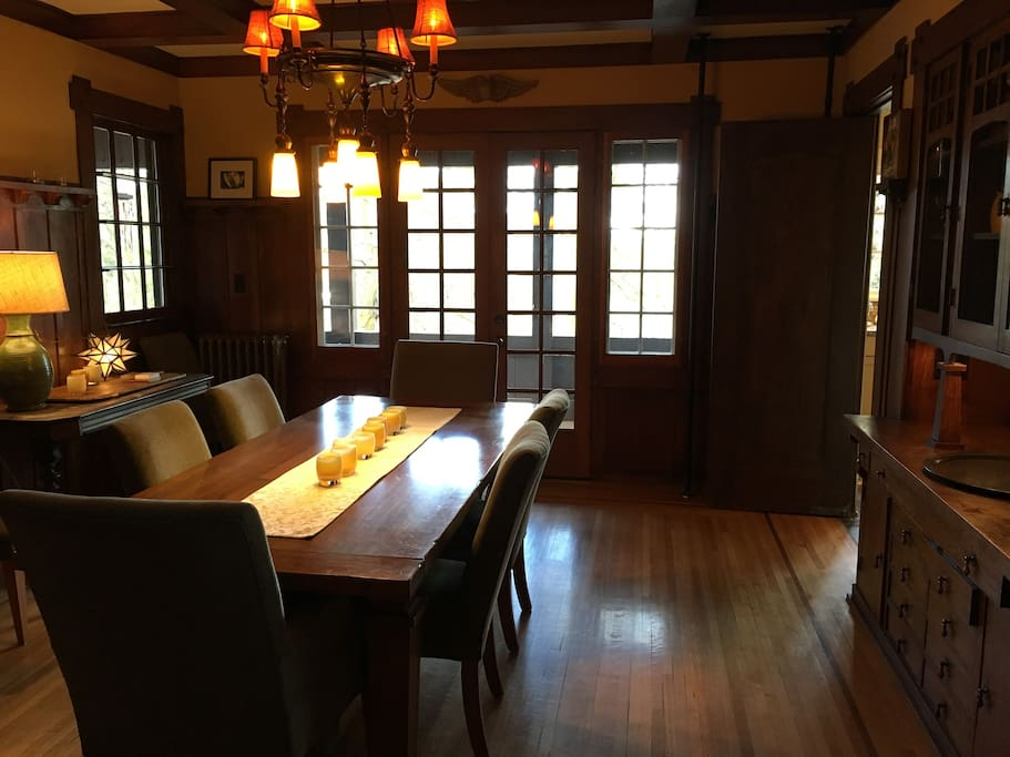 "Formal dining room.  Table seats 10,  walk through to kitchen, doors open onto back ""tree house"" porch.  Beautiful woodwork (box beams and original built in hutch)."