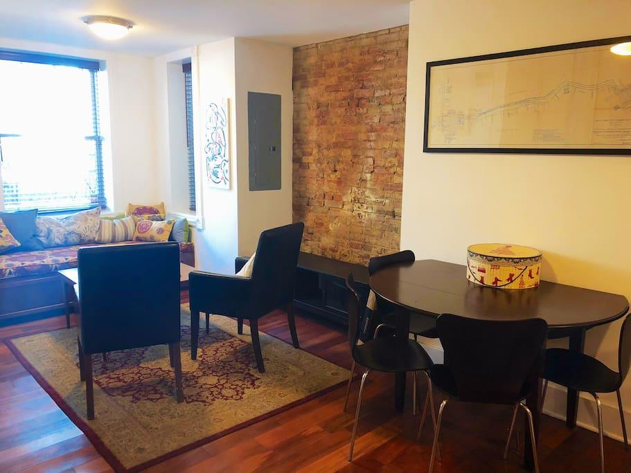 Bright, open floor plan with exposed brick