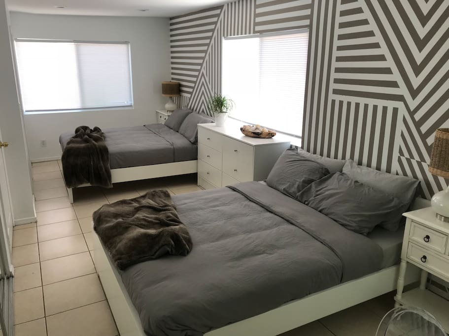 Two Queen beds in the bedroom. The huge bedroom has two queen beds and a desk area and two large closets. The bathroom is off the bedroom. Luxurious linens and down and down-free pillows.