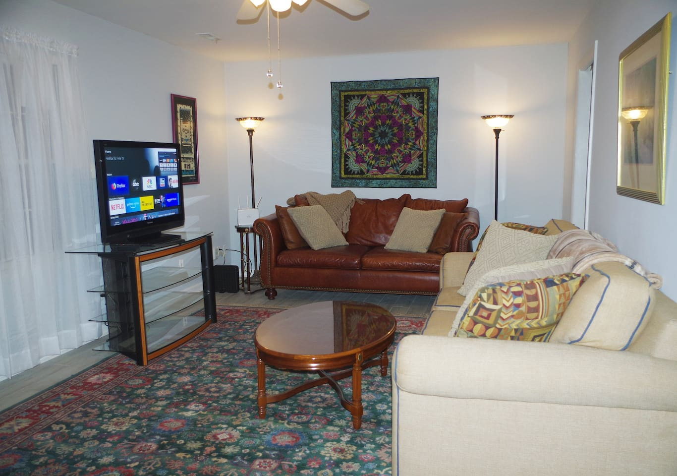 "The Living Room has 2 long sofas which could be used for extra ""single"" sleep space if needed by removing back cushions. Unit could accommodate 8 adults and 2 children. There is an extra charge of 10$ per adult over 6 adults."