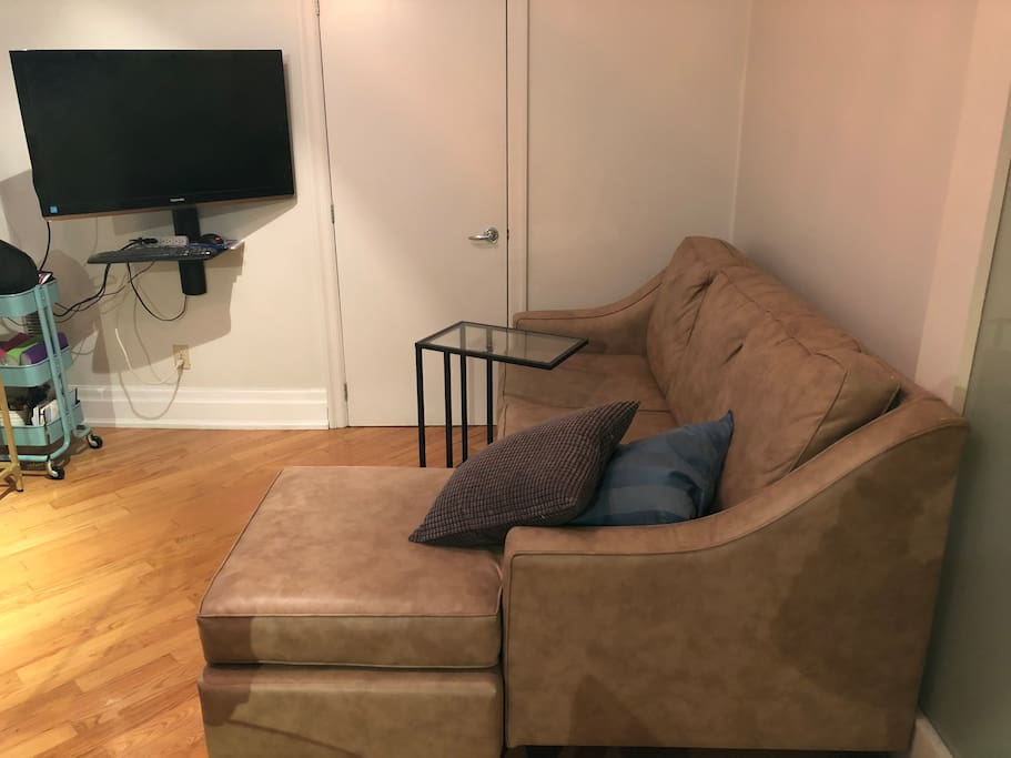 "Large sofa in the living room that can sleep an extra guest. Enjoy relaxing at the end of your day with 42"" flat screen tv connected to google home and chromecast, you can also hook up your own computer via HDMI."