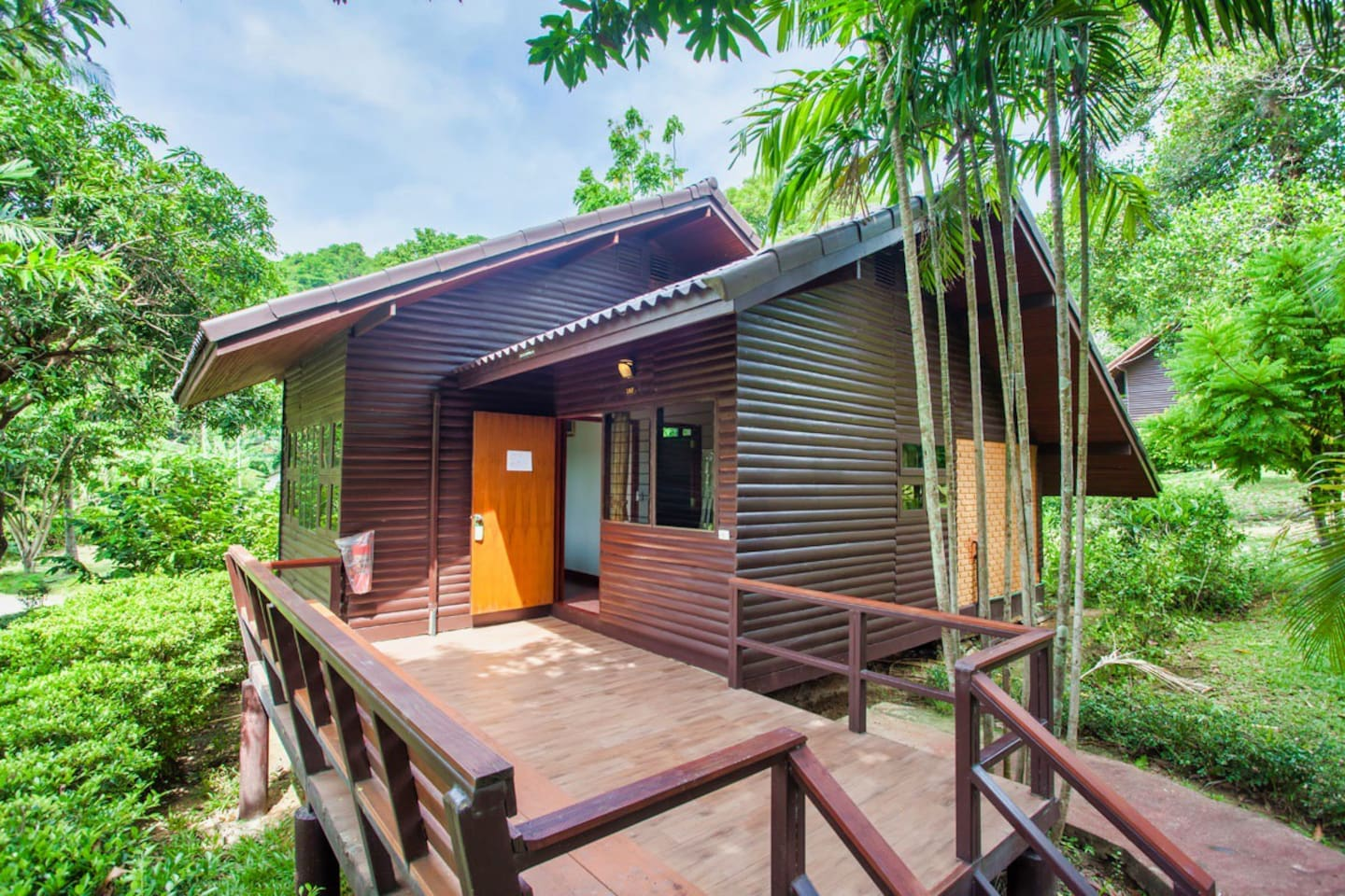 a classic Thai design with a spacious balcony overlooking the lush gardens and a living area inside to relax with air-conditioning.
