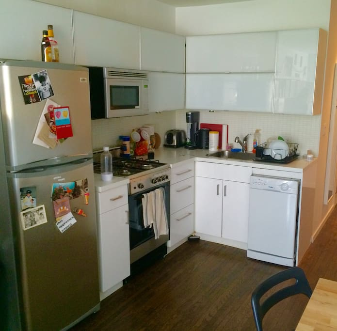 kitchen has all the basics: microwave, oven, dishwasher