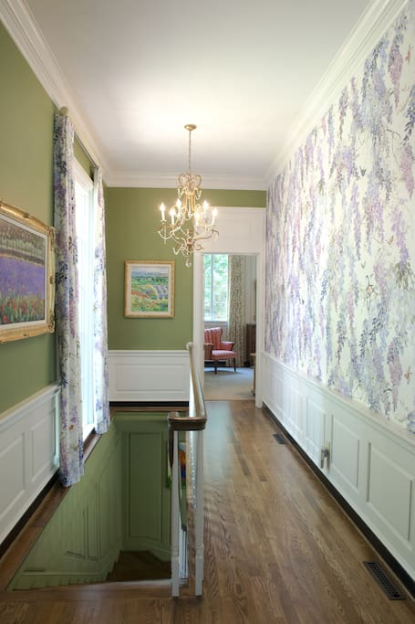 Wisteria Hallway toward Boxwood Suite and stairway to Garden Level on left