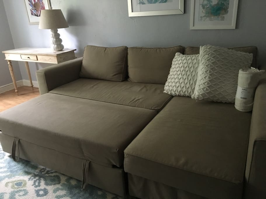 Living room sofa bed with trundle pulled out to sleep