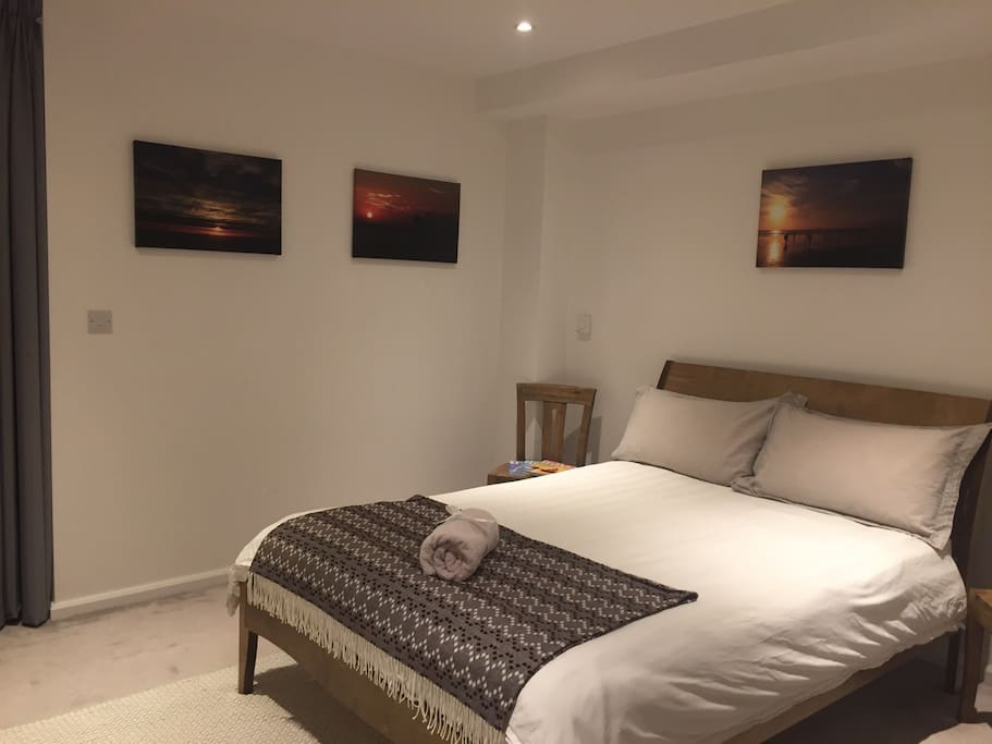 Warm spacious bedroom with luxury double bed