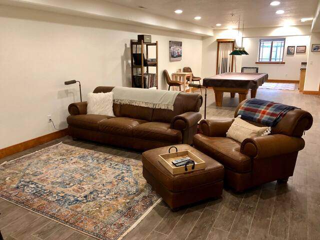 Your private living room with leather couch and chair  - Roku included