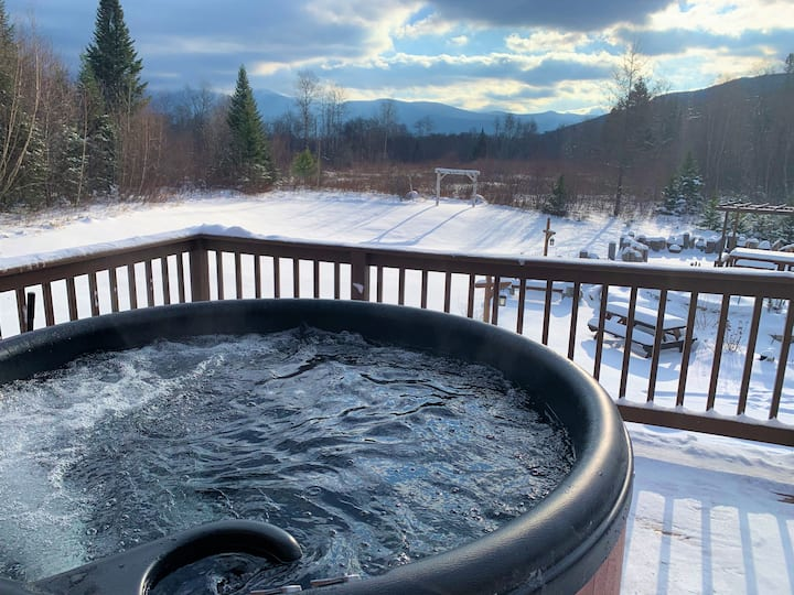 """1800ML: PROFESSIONALLY MANAGED! """"As Seen on TV"""" Private home with SPECTACULAR scenery, HOT TUB, AC, beach, fishing, pool table, outdoor kitchen, fire pit! 1 mi to ski area.  Great for weddings/events. On site trails!"""
