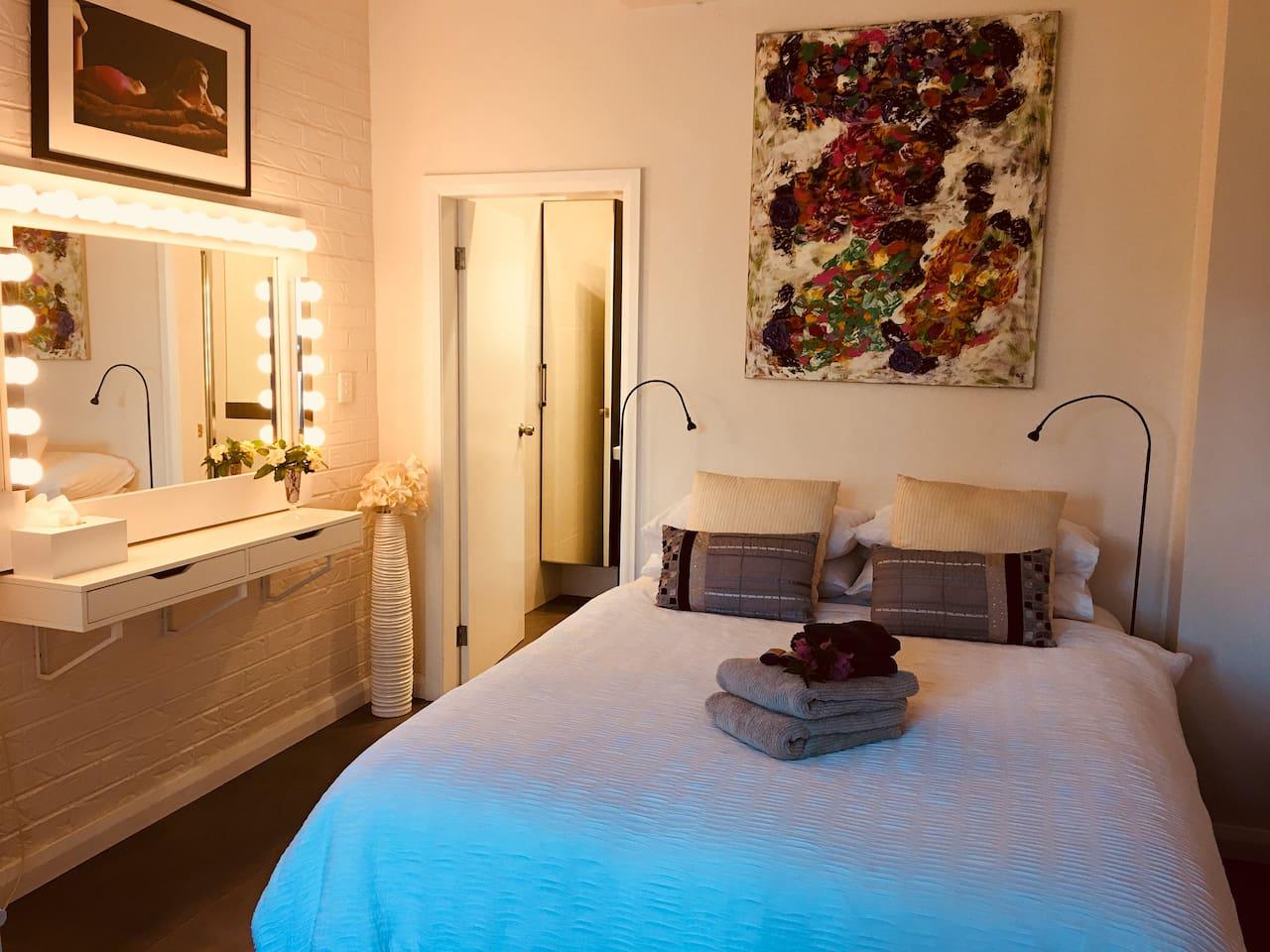 Reverse-cycle air conditioned studio with en suite bathroom.