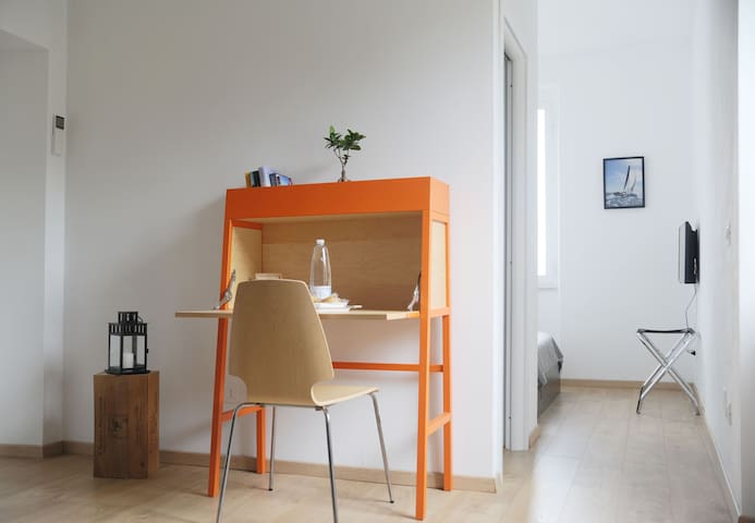 a desk to write your postcard home