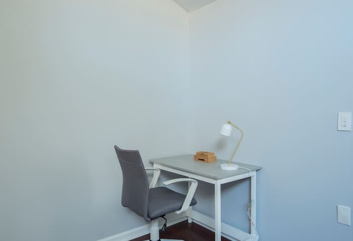 Desk with comfortable chair for working.