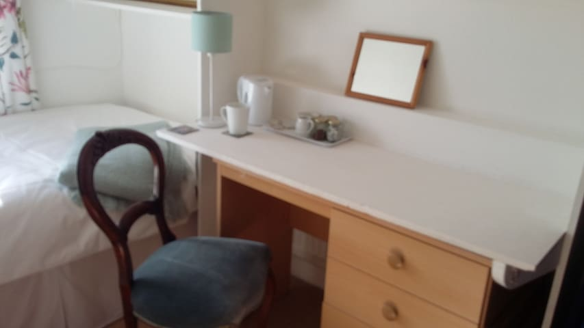 Work desk.  Tea and coffee facilities.  Plenty or wardrobe space and drawers