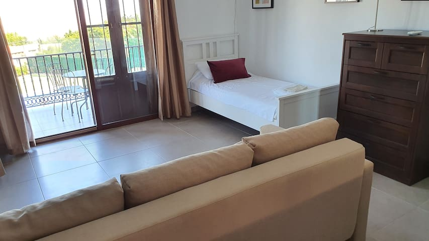 Upstairs bedroom with double sofa bed and single bed