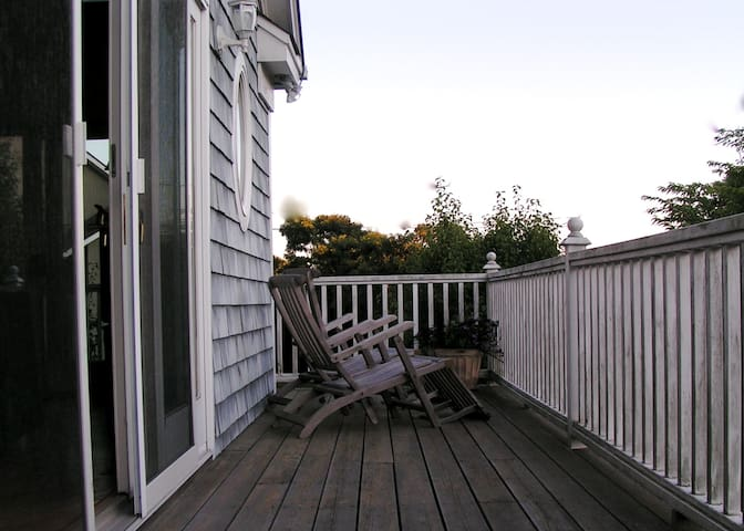 Relax on the front deck for a quiet morning or sunset view.