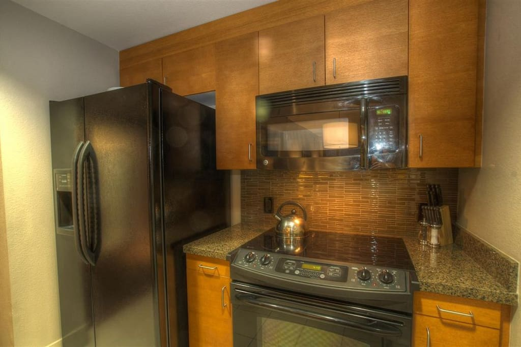 Full size refrigerator, oven and cooktop