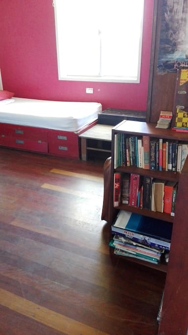 A little library in the entrance of the room, choose one and chill out!