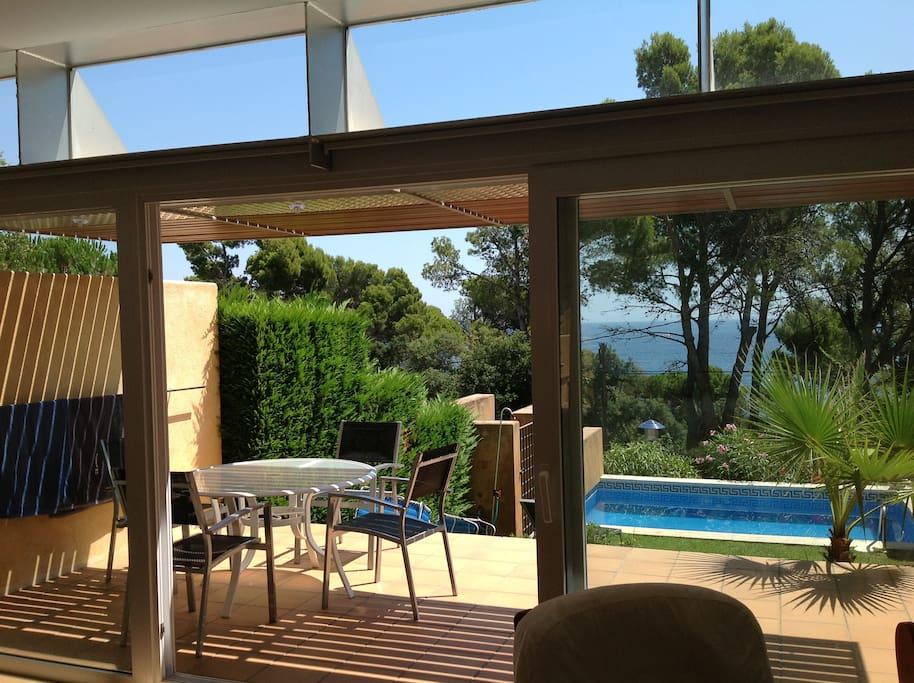 view of the terrace, garden , swimming pool and the sea in the background
