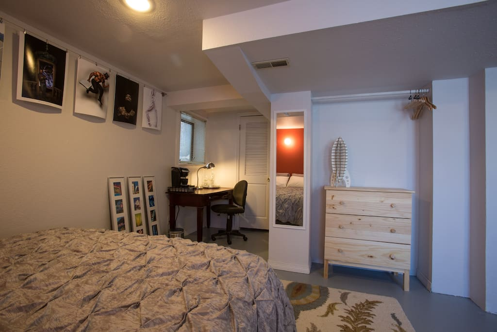 The room includes a desk with a Keurig K-cup coffee machine.