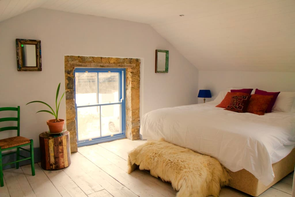 The grainstore in the old hayloft, with superking sized bed and view over the  gardens. Also available to rent.