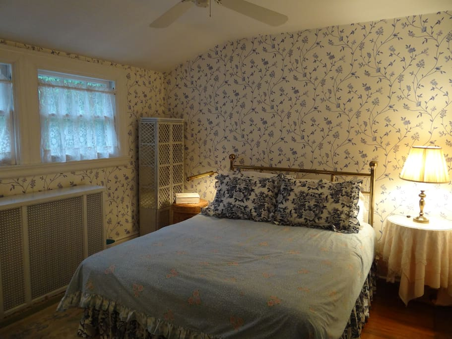This listing features the blue and white guest room, with a Queen size bed on third floor and ceiling fan.