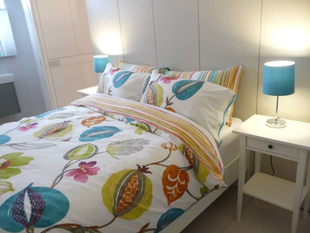 With soft lighting the bedroom is both comfortable and romantic