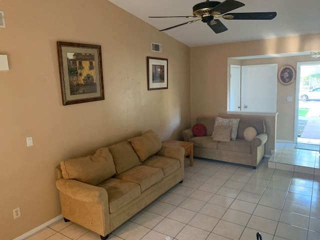 This is the living room, it is a shared space.  Living room includes sofa and love seat,  cable T.V.