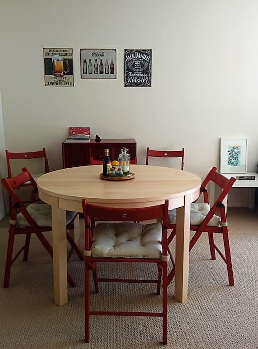 The table is expandable, there are 2 more chairs and another seat.