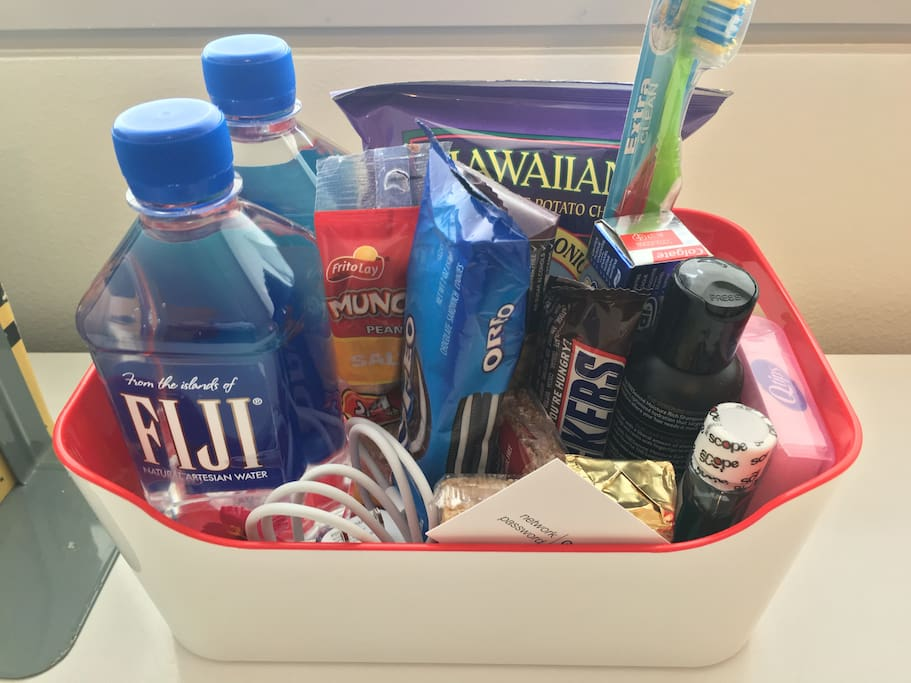 Your Guest Room |  Welcome basket with water, snacks, power cord, wifi password, and bathroom sundries.