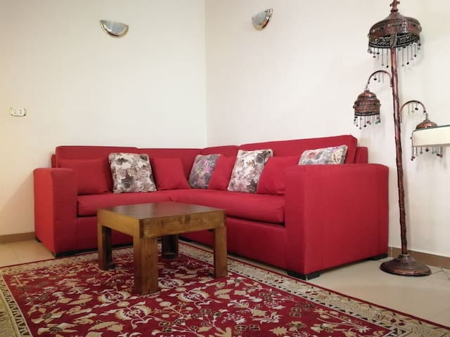 Big couch for relaxing and watching TV. It´s possible to change it to an extra bed for one big or two small persons.