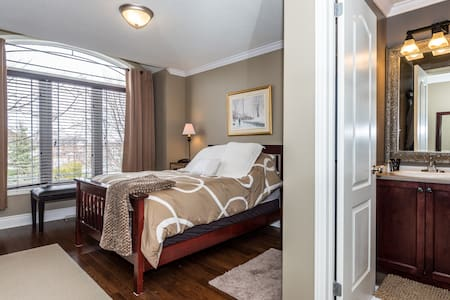 Elegant Queen bed guest room with ensuite bath