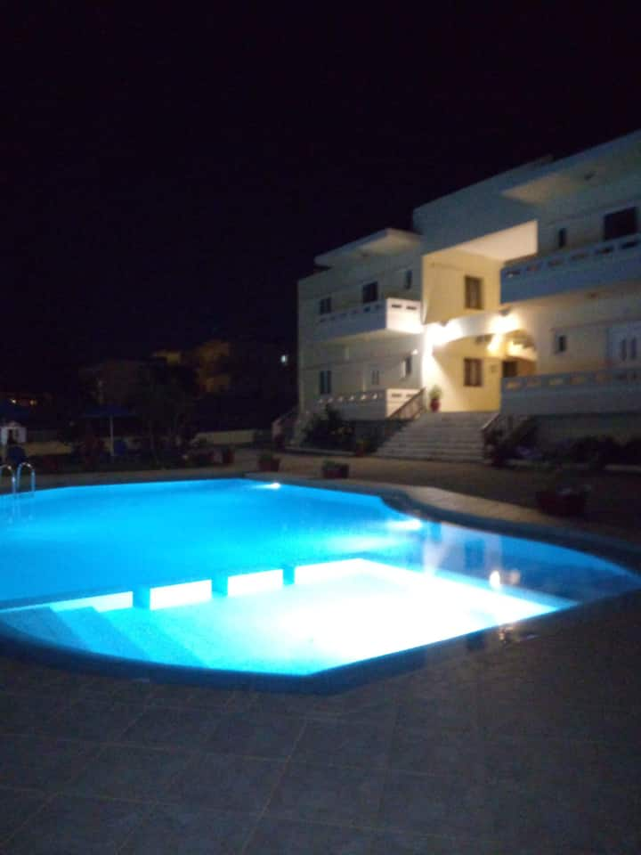 Litinas Aprt with balcony in front of the pool