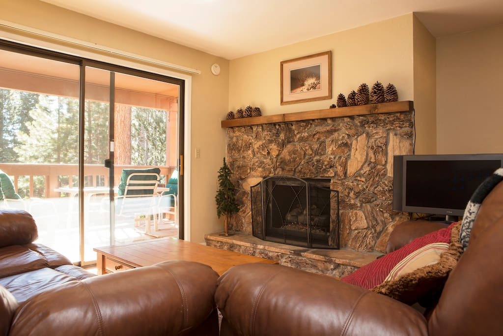 Gas log fireplace and leather couches.