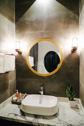 Bathroom with modern sink and mirror gives you nice moment to makeup!