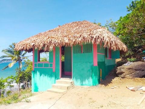 Tinagong Beach Kubo,  overlooking cottage