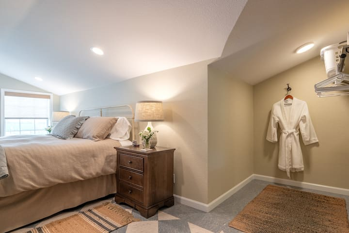 BEDROOM TWO: king bed, dresser, two night stands, bench, two mirrors, and ample closet space.