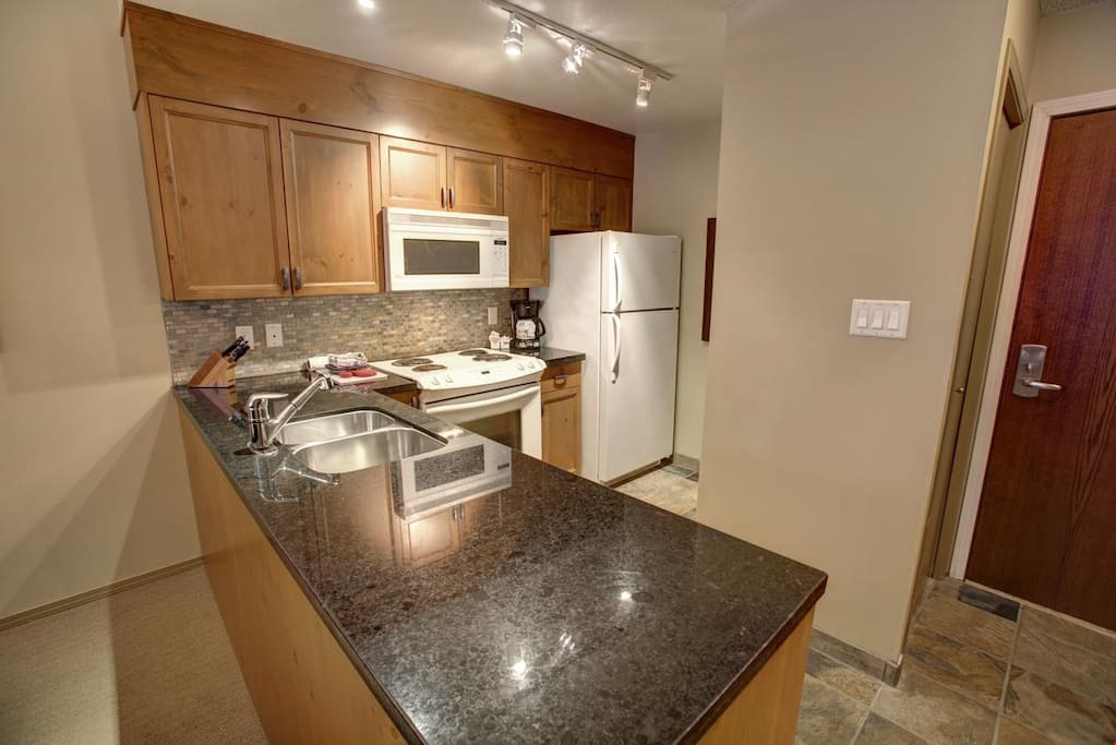 Granite counter tops in the kitchen, double sinks, microwave and more are included.