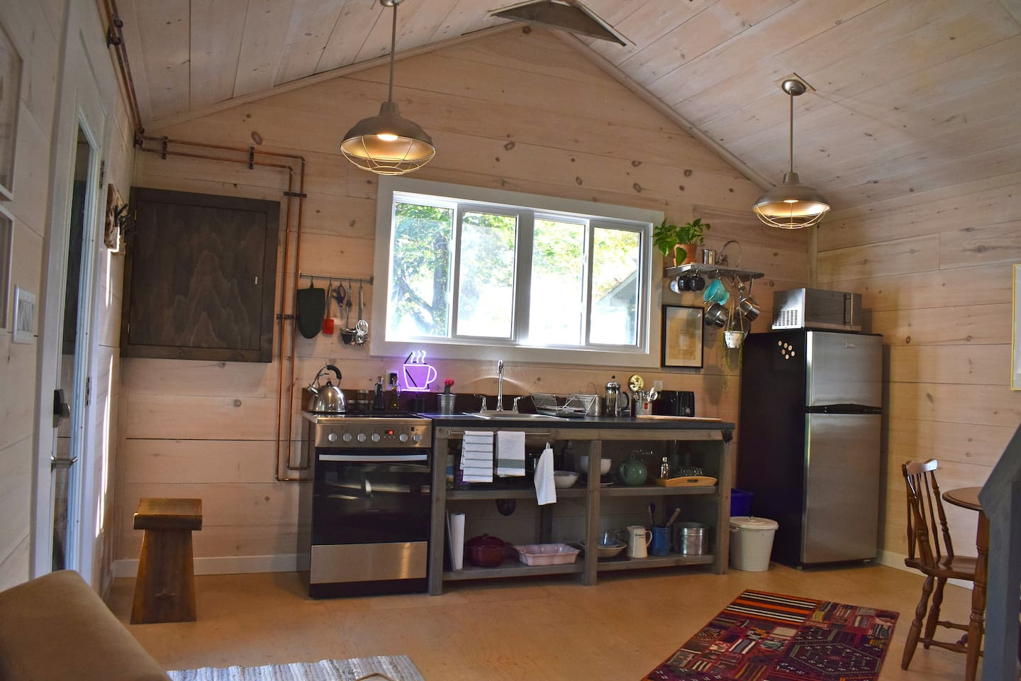 Studio style custom kitchen with brand new stainless steel oven and stove top, fridge, and microwave.  We provide all the cutest ware for you to prepare your favourite meals and snacks with notes on where to buy fresh local fare from the county.