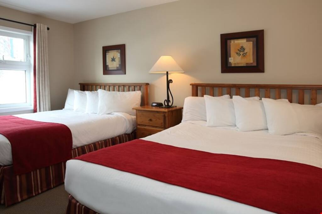 In the master bedroom, get a good night's sleep in either two queen beds or one king.